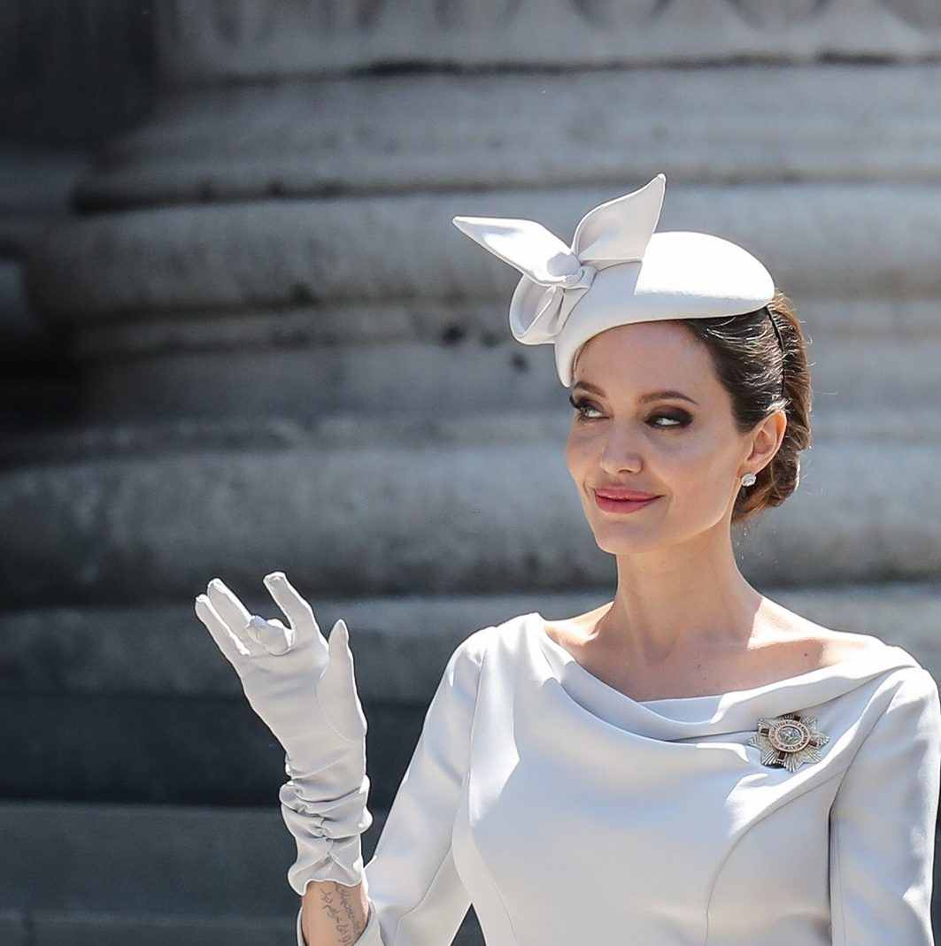 Angelina Jolie Wears an OVERSIZED Hat to Order of St. Michael & St. George Service image