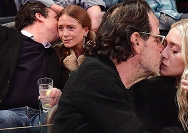 Intergenerational Romance: Ashley Olsen and Richard Sachs Smooch at Sports Game!