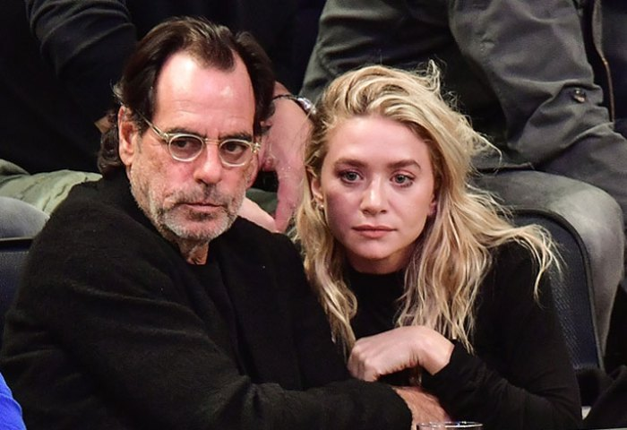Intergenerational Romance: Ashley Olsen and Richard Sachs Smooch at Sports Game! image