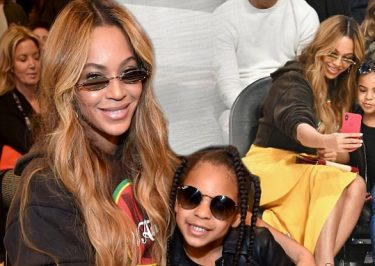Beyoncé Takes Selfies With BLUE IVY at NBA Game