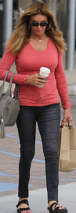 Caitlyn Jenner Shows Off Figure in Skin-tight Coral Sweater Paired With Jeans image