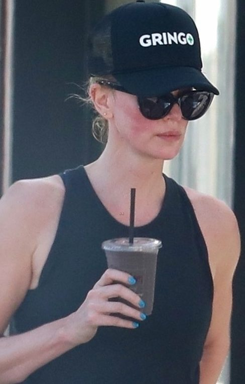 Charlize Theron Wears Abusive Hat to Work Out image