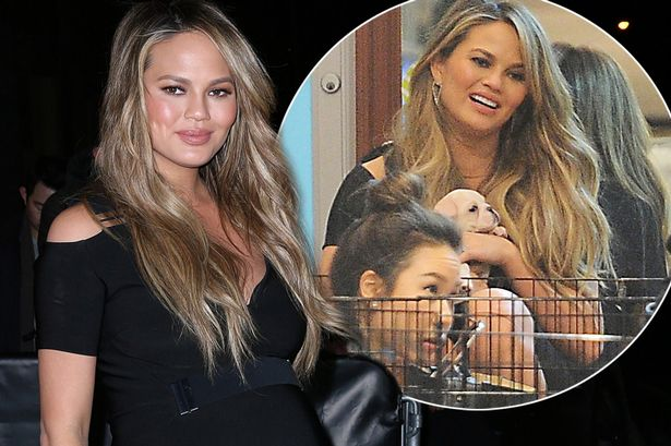 Chrissy Teigen Wants to Become a 'REAL HOUSEWIFE' image