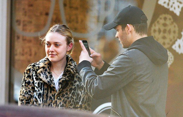 ALL SMILES: Dakota Fanning and Mystery Man Hold Hands in NYC! image
