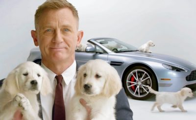 Daniel Craig Cuddles Puppies in ADORABLE NEW VIDEO For Charity