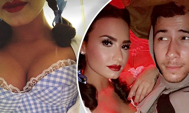 Demi Lovato and Nick Jonas are DOROTHY and Scarecrow for Halloween! image