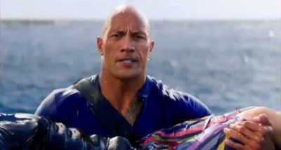 Dwayne 'THE ROCK' Johnson Carries Unconscious Woman in First BAYWATCH Trailer