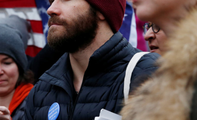 Jake Gyllenhaal Wears WOMEN ARE POWERFUL & DANGEROUS Button at March