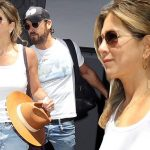 Can't Hide Her Grin: Jennifer Aniston Holds Tight On Husband Justin Theroux in Wake of Brangelina Divorce Scandal image