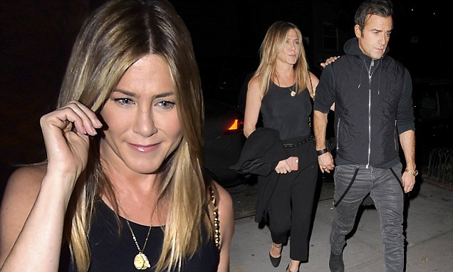 Jennifer Aniston and Justin Theroux happily hold hands after dinner