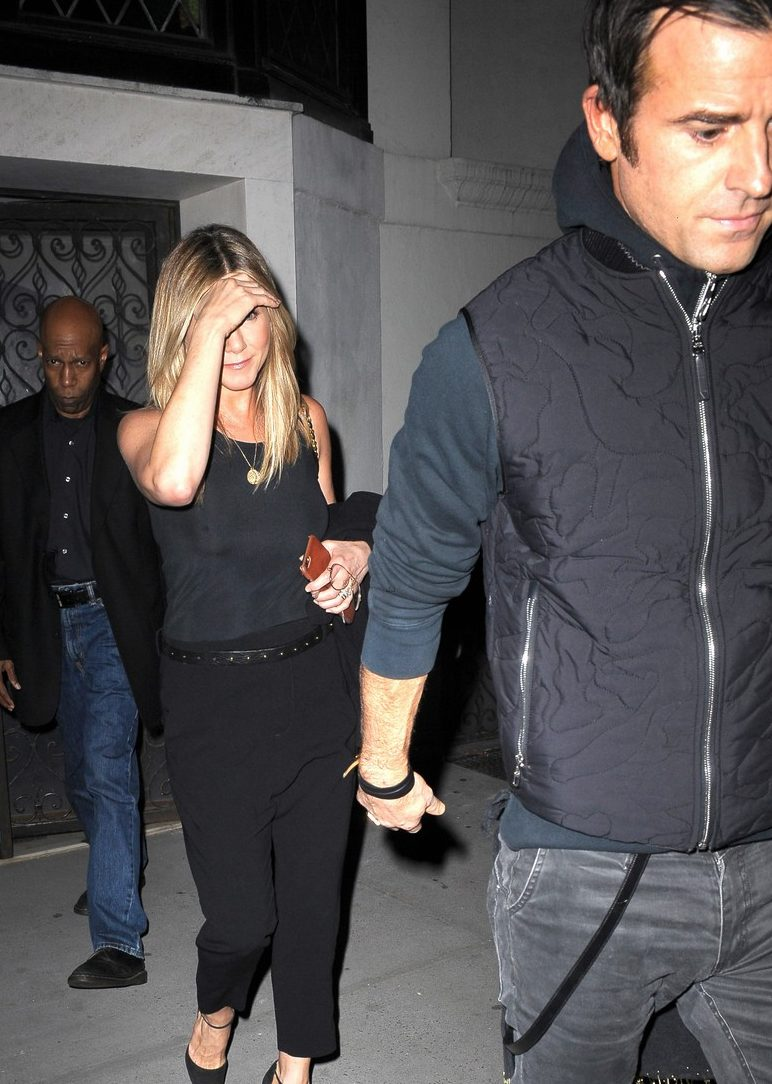 Can't Hide Her Grin: Jennifer Aniston Holds on Tight Onto Husband Justin Theroux in Wake of Brangelina Divorce Scandal
