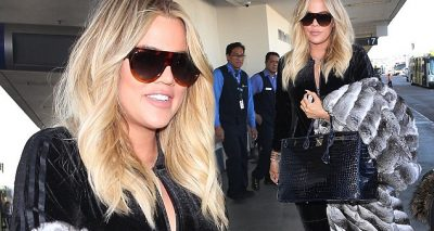 Khloe Kardashian Leaves Los Angeles Before NYE, Covers Baby Bump!