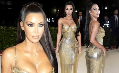 KIM KARDASHIAN Wears Crucifix-Adorned GOLD DRESS at Met Gala 2018!