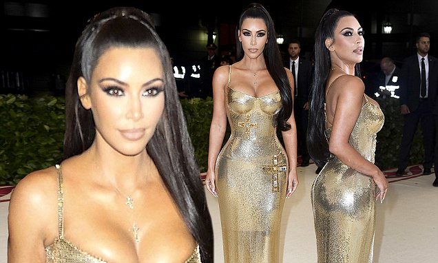 KIM KARDASHIAN Wears Crucifix-Adorned GOLD DRESS at Met Gala 2018! image