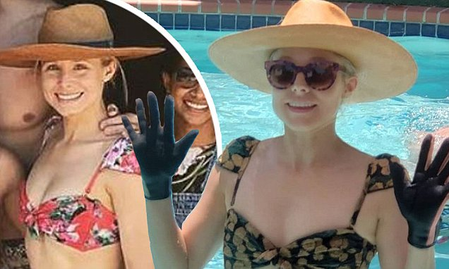 Kristen Bell Wears GLOVES While Swimming! image