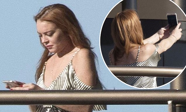CARNIVORE: Lindsay Lohan Whips Up Scallops & Crab Claws Meal