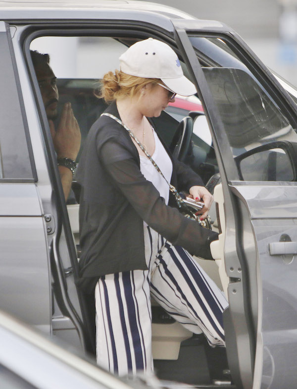 Lohan On: Lindsay Lohan's New Man Denis Papageorgiou Drops Her Off at Airport and Blows Goodbye Kiss