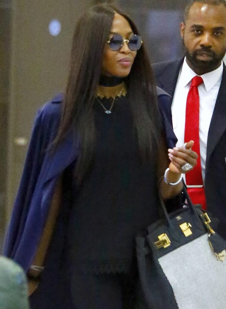 Naomi Campbell Strolls Through NYC Airport With SUPREME Luggage! image