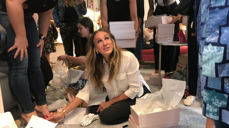 Sarah Jessica Parker Puts Shoes on Women During Opening of SJP SHOE SHOP! image