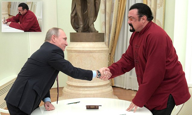HERE YOU GO: Vladimir Putin Personally Gives Steven Seagal A RUSSIAN PASSPORT! image