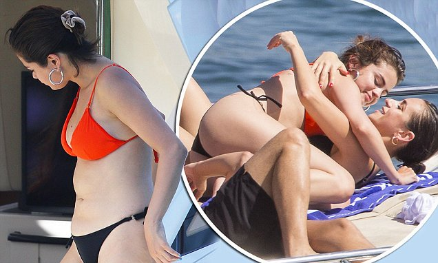 SELENA GOMEZ In an Orange Bikini! Eats Avocado image