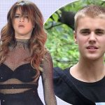 FIGHT BACK: Watch Justin Bieber PUNCH a Fan Who Stuck Hand in Bieber's Window! image