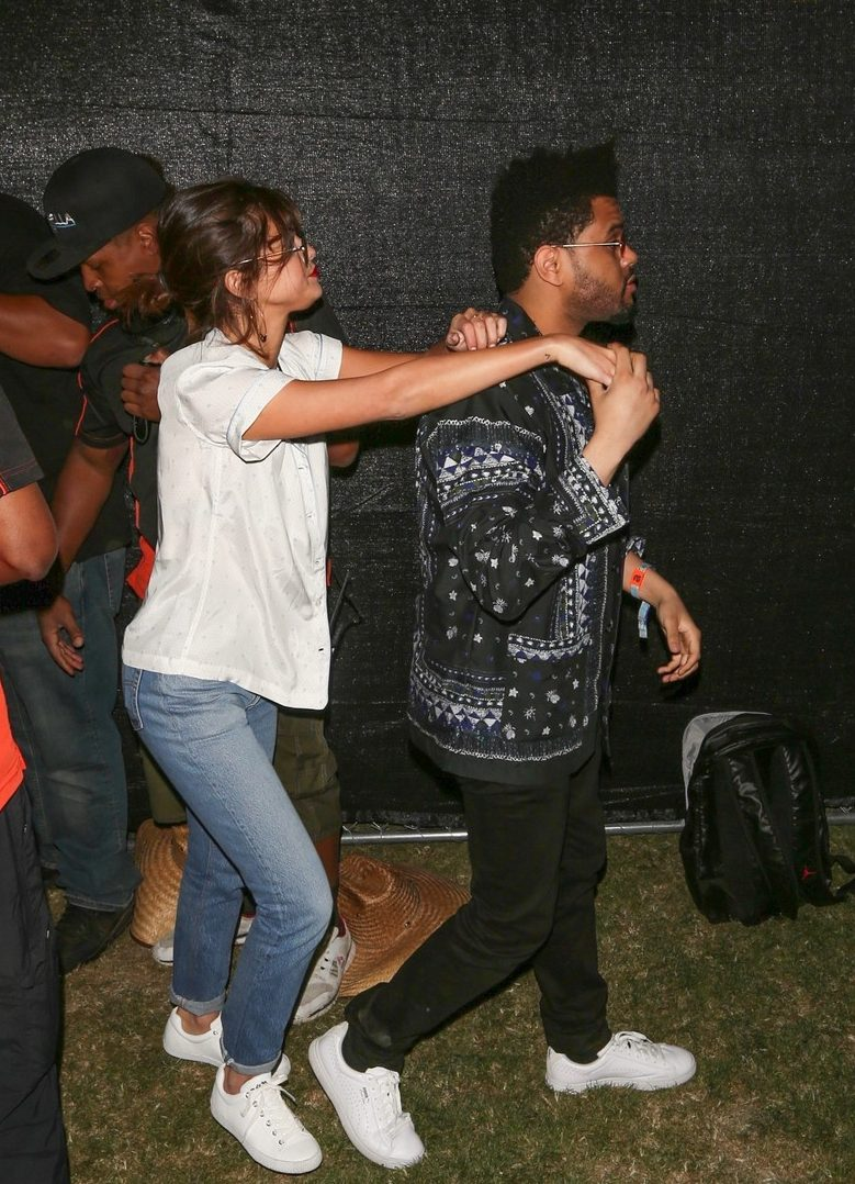 SELENA GOMEZ and The Weeknd Get Handsy During Coachella!
