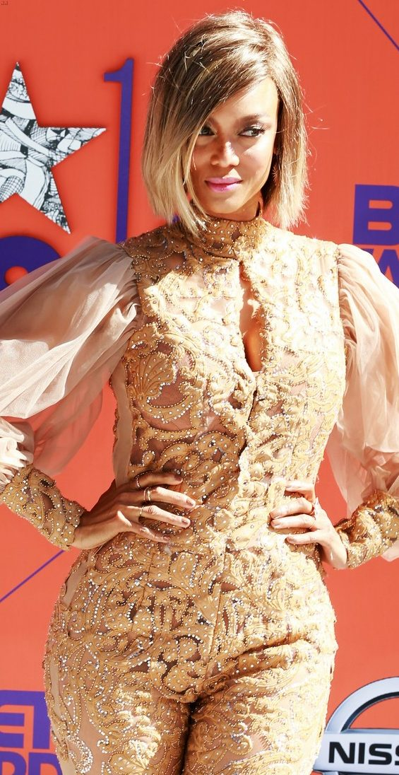 Tyra Banks Wears SEE-THROUGH Gold Outfit to BET Awards! image